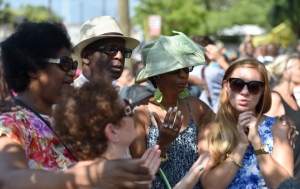 People pray and listen to the Sunday service outside of the Emanuel AME Church in Charleston, South Carolina on June 21, 2015. Large crowds arrived at Sunday's service at the black church in Charleston where nine African Americans were gunned down, as a chilling website apparently created by the suspected white supremacist shooter emerged. The service will be the first since the bloodbath on Wednesday at the Emanuel African Methodist Episcopal Church in the southern state of South Carolina, which has fuelled simmering racial tensions in the United States and reignited impassioned calls for stronger gun-control laws. AFP PHOTO/ MLADEN ANTONOV        (Photo credit should read MLADEN ANTONOV/AFP/Getty Images)
